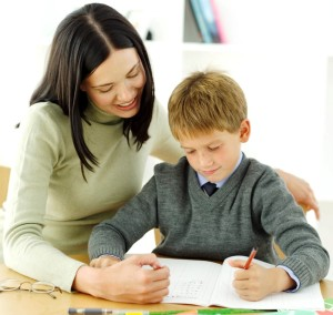 Young Boy Being Tutored by His Teacher --- Image by © Royalty-Free/Corbis